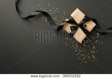 Black Friday Sale Flat Lay With Stylish Gift Box Present And Ribbon With Gold Star Glitter On Black