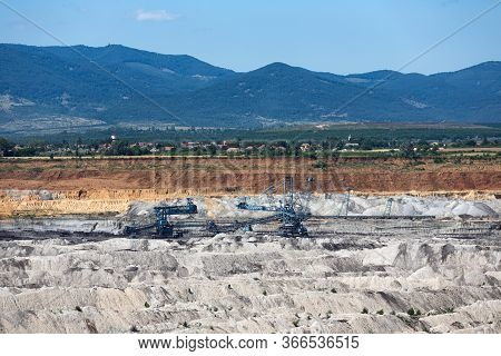 Brown Coal Open Pit Landscape With Enormous Digging Excavator In Matra Mine Hungary, East Of Budapes