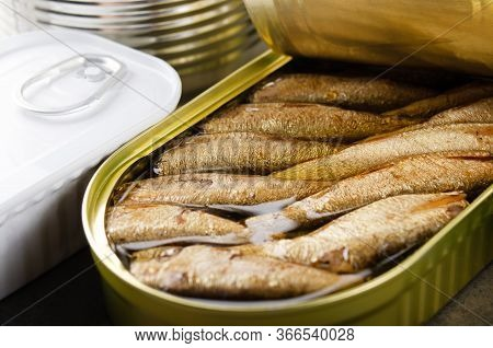 Canned Smoked Fish Sprats In Just Opened Tin Can. Non-perishable Food