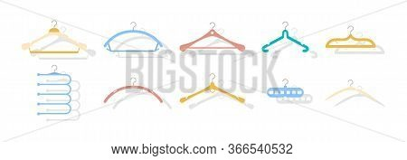 Set Of Colored Coat Hangers On The White Background. Collection Includes Wooden, Plastic, Metallic M