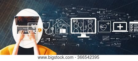 Telehealth Theme With Person Using A Laptop On A White Table