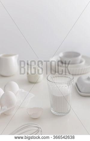 Minimal White Bakery Ingredients, Eggs, Ceramic Pan, Sugar, Plain Yogurt, Whisk