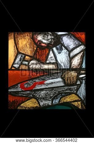 SONTBERGEN, GERMANY - OCTOBER 20, 2014: Moses, the journey of the nation at the end of the day on Mount Sinai, detail of stained glass by Sieger Koder in Saint James church in Sontbergen, Germany