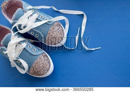 Fashionable Blue Sneakers For Girls Isolated On Blue Background. Pair Of Trendy Kids Sports Shoes.tr