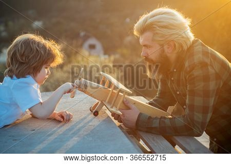 Father And Son With Toy Airplane Dreams Of Traveling. Father Playing With Kid. Dream Of Flying. Fath