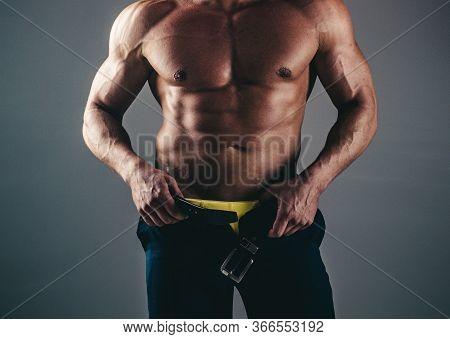 Muscular African American Black Athletic Fitness Model Wearing Black Hoodie With Six Pack Abs In Stu