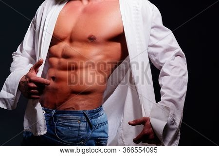 Sexy Gay. Muscular And Sexy Torso Of Young Man, Isolated On Black Background. Men Abs In White Shirt