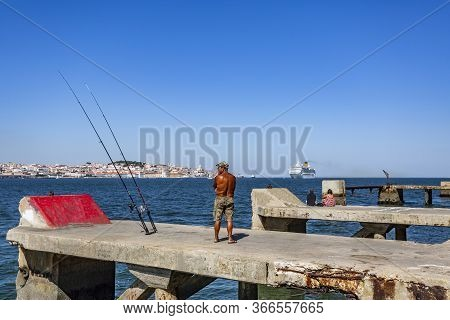 Almada, Portugal - September 07, 2019: Panoramic View Of A Cruise Ship Leaving Port Seen From The Ta