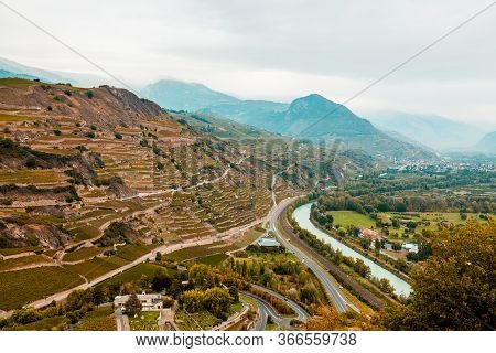 Sion, Switzerland: The Valley Of The Rhone River And Vineyards Seen From Tourbillon Castle Hill, Can