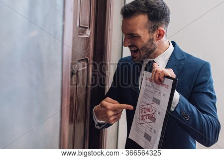 Angry Collector Pointing At Documents With Foreclosure And Final Notice Lettering And Shouting Near