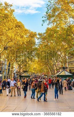 Barcelona, Spain - November 07 2018: Crowded Day In La Rambla/ Las Ramblas, Catalonia. People Walkin