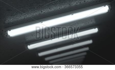 White Double Fluorescent Lighting In Industrial Building. On The Ceiling Of A Dark, Cold Room. Close