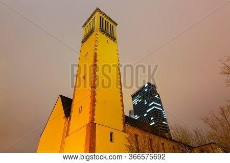 Matthaeuskirche In Front Of Skyscraper In Frankfurt Am Main, Germany