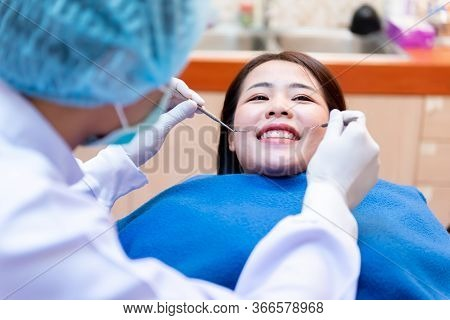 Dentistry And Teeth Healthcare Concept At Dental Clinic. Dentist Check-up Teeth For Young Asian Pati