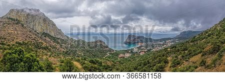 Cloudy Spring Landscape Overlooking The Resort Town And Juniper Forest From The Mountains Of Crimea.
