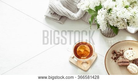 Cozy Spring Composition With Tea And Blooming Lilac.