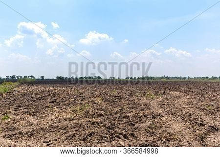 Earth Soil Grooves Farming Earth Soil Grooves Over Field. Sepia Effect Natural Organic Soil Texture.