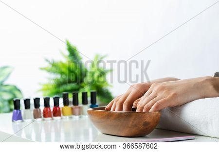 Closeup Female Hands In Wooden Bowl With Water. Spa Procedure And Relaxation. Female Hands Preparing