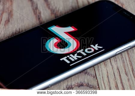 Tiktok Application Icon On Apple Iphone 11 Screen Close-up. Hand Holding Smartphone Tik Tok Icon On
