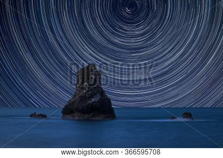 Digital Composite Image Of Star Trails Around Polaris With Beautiful Long Exposure Peaceful Landscap
