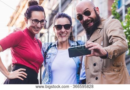 People Taking Picture With Cell Phone. People With Cell Phone On City Street. People Taking Selfie W