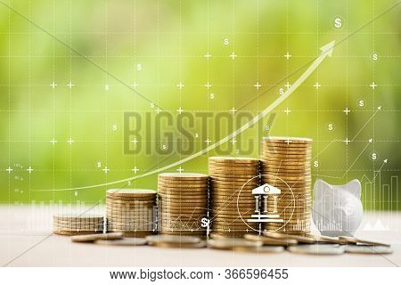 Financial And Banking / Finance And Business Concept:  Arrange Rows Of Increasing Coins And Graph Gr