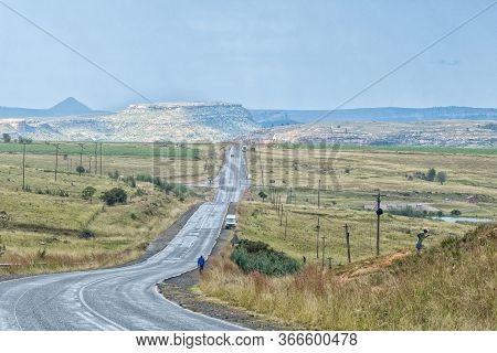 The Landscape On Road R26 To The South Of Fouriesburg. People And Vehicles Are Visible