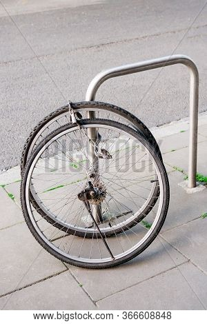 Bike Wheels With Padlock. Theft Of A Bicycle. Bicycles Stolen And Left Only Wheels. Bicycle Theft Cr