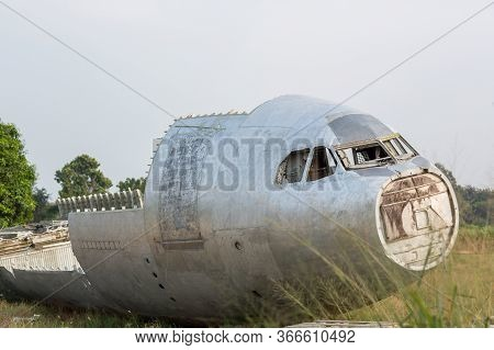 Crash-landed Aircraft. Airplane Wreckage In Jungle - Old Propeller Aircraft In Forest. An Airplane T