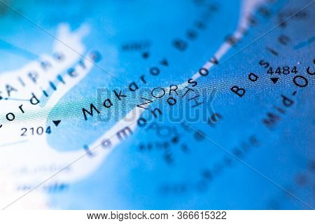 Shallow Depth Of Field Focus On Geographical Map Location Of North Pole Arctic Region In Arctic Cont