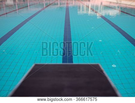 Starting Blocks In Row By The Swimming Pool, Selective Focus. Jump Platform For Swimming In Swimming