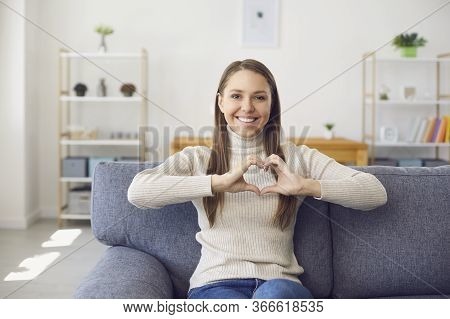 Online Dating Video Chat Call. Smiling Woman Looks At The Camera Online Holds His Hands In The Shape