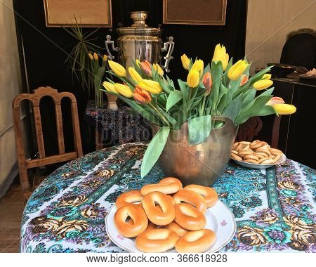 Traditional Painting For Russian Easter And Shrovetide With A Samovar, Bagels And Flowers.