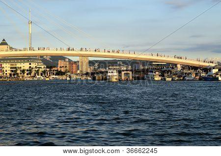 Tourist pedestrian bridge near tropical resort hotel