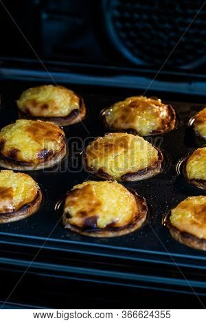 Pasteis De Nata Or Belem Tart. Portuguese Custard Made With Egg, Cinnamon, Sugar And Flour In Muffin