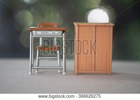 Miniature Learning Desk And Miniature Cabinet. Concept Of Back To School