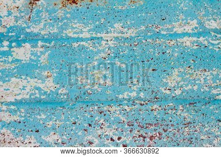 Peeling Paint On Metal Close-up With Copy Space. Rough Texture With Peeling Paint. Workpiece For Des