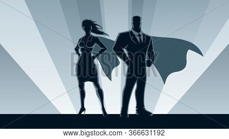 Super Businessman And Super Businesswoman Posing In Front Of Light.