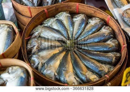 Steamed Mackerel Sold In The Market. Thai Steamed Mackerel Fishes In Bamboo Basket For Sale At The M