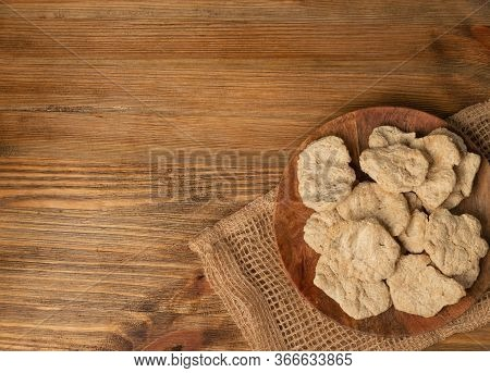 Raw Dehydrated Soy Meat Or Soya Chunks On Wood Background