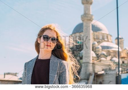 Beautiful Girl With Blond Hair Stands In Old City Of Istanbul With View To Suleymaniye Camii And Bos