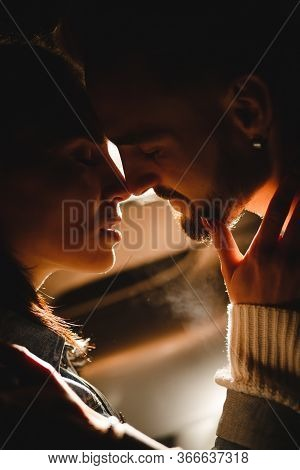 Man And Woman Touching Each Other With Their Noses Before Kissing
