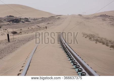Abandoned And Forgotten Railway Being Taken Over By Encroaching Sandstorm, Kolmanskop Ghost Town, Na