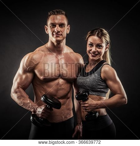 Fitness In Gym, Sport And Healthy Lifestyle Concept. Couple Of Athletic Man And Woman Showing Their
