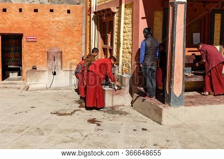 Kagbeni, Mustang District, Nepal - November 19, 2016: Buddhist Monks Teenagers Wash Dishes After Din