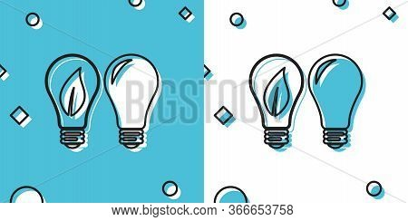 Black Classic Lamp And Light Bulb With Leaf Inside Icon Isolated On Blue And White Background. Light