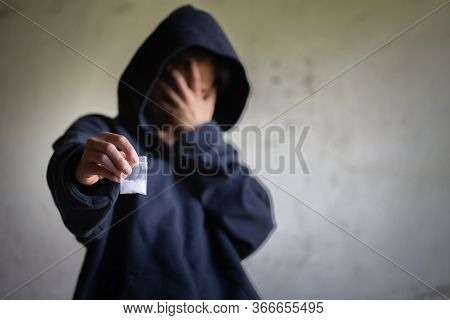 Hand Of Addict Man Holding Cocaine Or Heroine, Close Up Of Addict Buying Dose From Drug Dealer, Drug