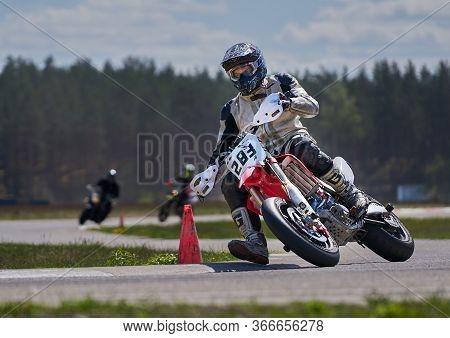 10-05-2020 Ropazi, Latvia Motorcyclist At Supermoto Rides By Empty Asphalt Road.