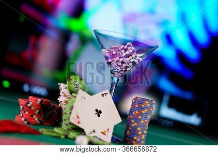 Craps dice in cocktail glass on the casino gambling table