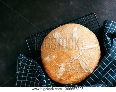 Wheat Round Sourdough Bread. Top View Of Delicious Homemade Sourdough Bread On Black Background With